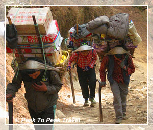 Local people carrying supplies