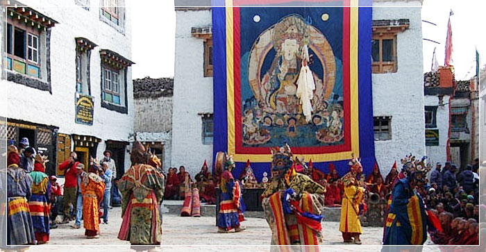 Tibetan monks performing a ritual dance during the Tiji Festival